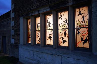 Mansion's illuminated windows