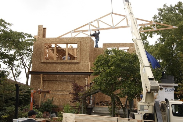 Jon the contractor placing a truss