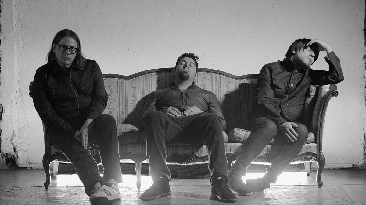 Crosses band sitting on a couch