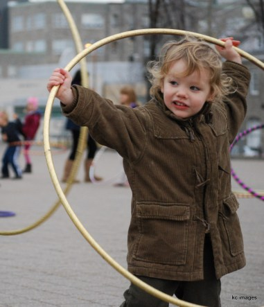 Little boy with golden hoola hoop