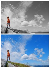the same photo twice. one is monochrome save for the young boy in an orange tshirt. the other is full colour of a blue sky with clouds and a slope the little boy is walking up.