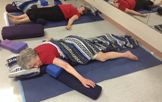 Restorative Yoga: Downward Facing Shavasana