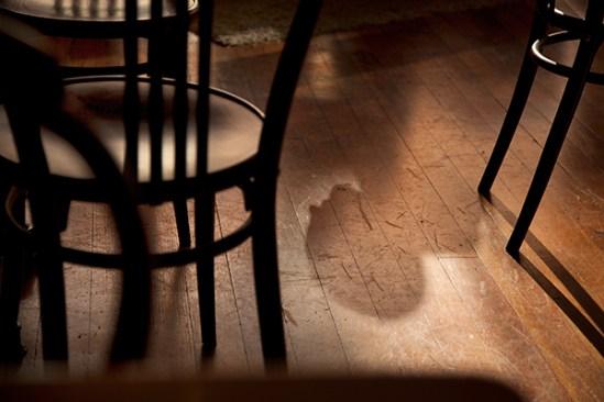 Shadows on floor of coffee shop