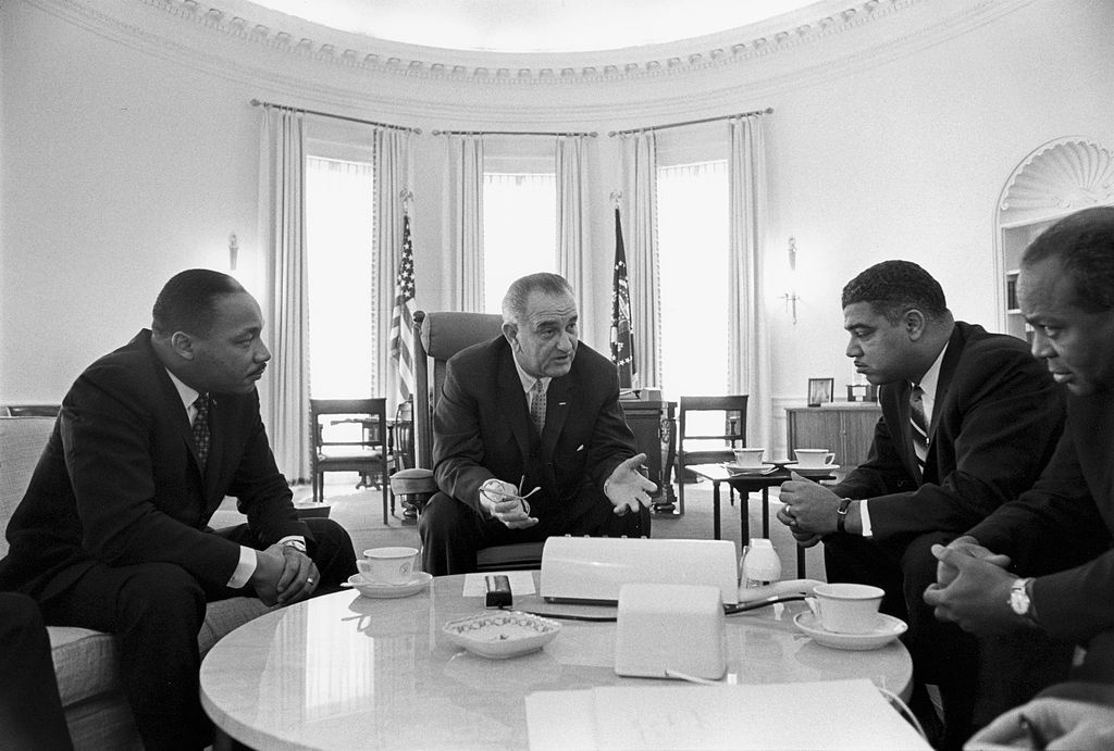 Lyndon Johnson meeting with civil rights leaders, including Martin Luther King Jr.