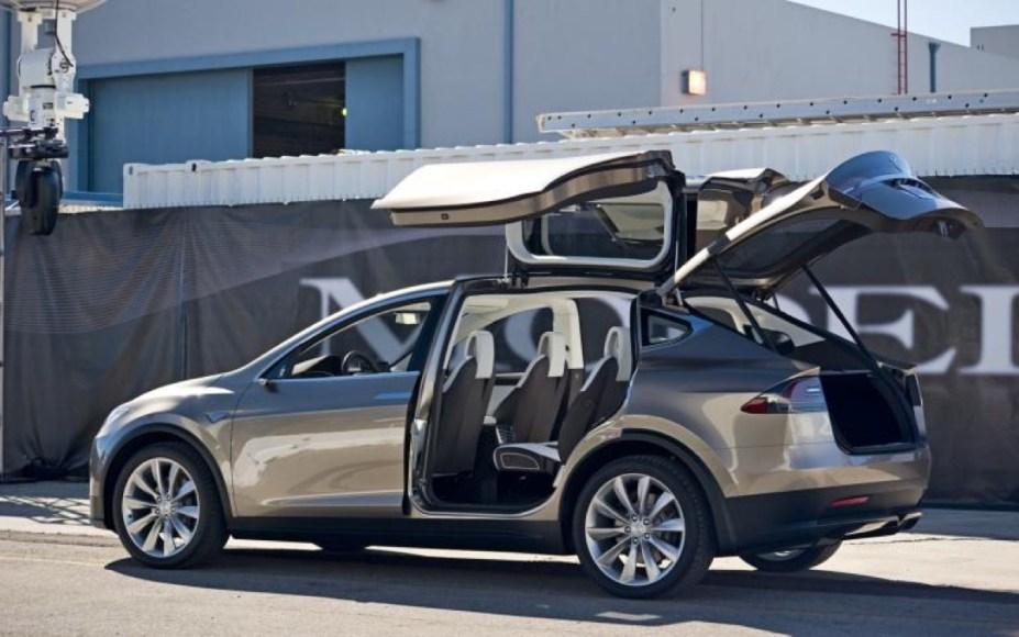 Tesla Model X. 100% electric. Range should be similar to Tesla's Model S (200 miles). Plus: Gull-wing doors.