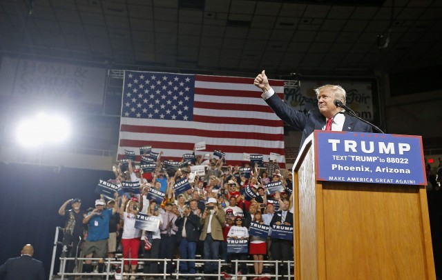 GOP presidential candidate Donald Trump waves to supporters at a rally in Phoenix, Arizona, on June 18, 2016.