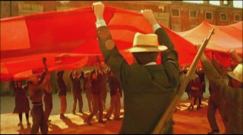 Workers raise their long hidden red banner