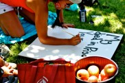 """Alicia Caballero-Christianson paints: """"My brother died in prison. Yours shouldn't have to. End Solitary & Mass Incarceration"""""""