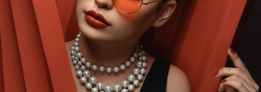 woman in sunglasses with beaded necklace