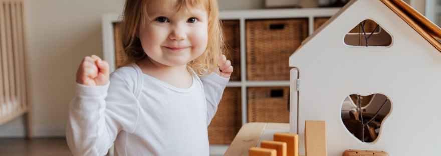 girl playing inside her room