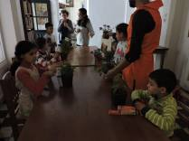 View of the children around the workshop table