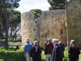 Participants walking through the ruins at Ksar Sghir