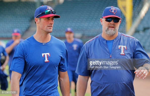 Texas Rangers starting pitcher Cole Hamels, left, and pitching coach Doug Brocail talk as they walk in from the outfield during practice at Globe Life Park in Arlington, Texas, on Wednesday, Oct. 5, 2016, ahead of the American League Division Series against the Toronto Blue Jays; Game 1 is on Thursday. (Rodger Mallison/Fort Worth Star-Telegram/TNS)