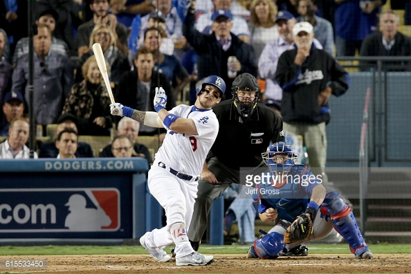 LOS ANGELES, CA - OCTOBER 18: Yasmani Grandal #9 of the Los Angeles Dodgers hits a two-run home run in the fourth inning against the Chicago Cubs in game three of the National League Championship Series at Dodger Stadium on October 18, 2016 in Los Angeles, California. (Photo by Jeff Gross/Getty Images)