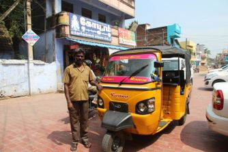 Pink and orange auto rickshaw