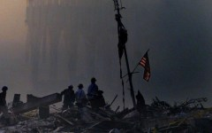9-11 responders with American flag at attack site