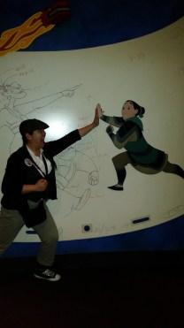 A newsie (that's me) gives Mulan a high 5.