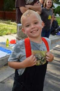 Emil Kunze was happy to get soaked with a water gun by one of the firefighters in the parade. Photo: Nicole Kunze