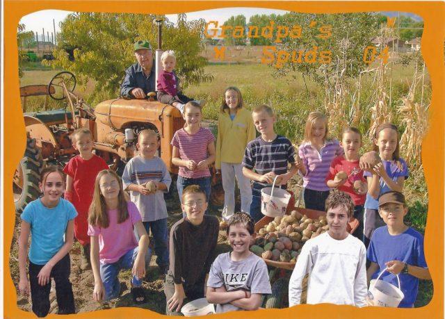 Paul with his grandchildren and great grandchildren after a potato harvest.