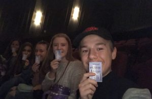 A group of Lehi friends poses with tickets to The Greatest Showman. This was their third time seeing the movie.