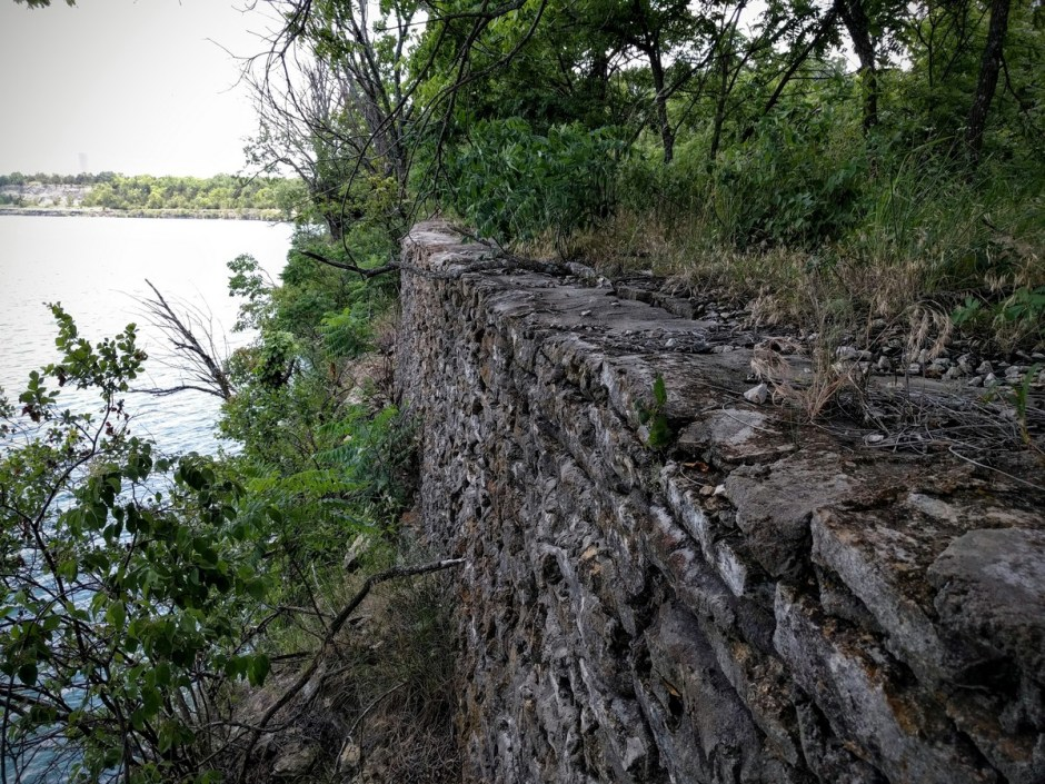 Along the bluffs, there are the remains of old stone walls.