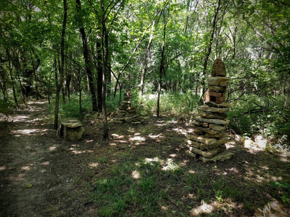 These rocks have been stacked by trail users, and they tend to change over time. WARNING: Rocks may be unstable, and if they fall, they can do severe damage. Do not allow children climb or play on these structures!