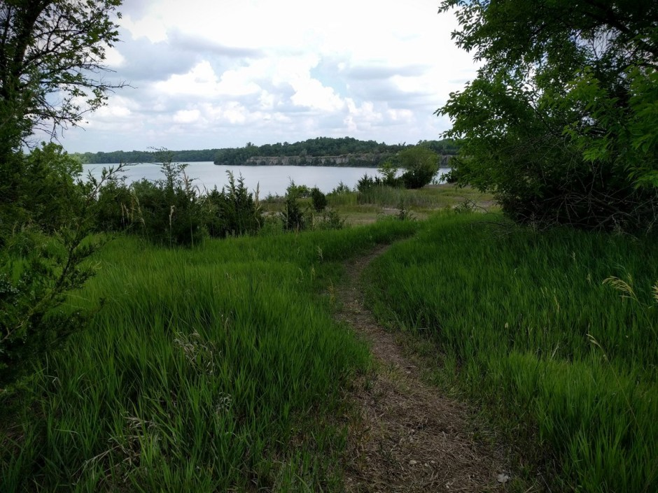 Heading north, the trail opens up into the Lehigh Prairie, with an expansive view of the lake ahead.