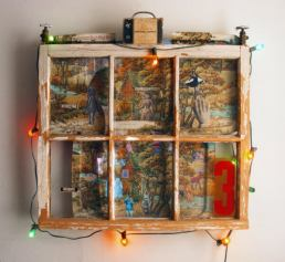 Annie Oakley – 32 x 31 x 4 Mixed media. Old window, folding TV tray, Christmas lights, collage, miscellaneous parts.