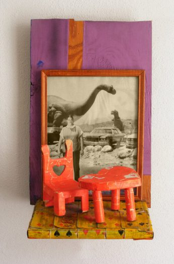 Dining Out (dinosaur cafe) – 17 x 18 x 3 Collage of magazine picture, paper and playing cards with wood.