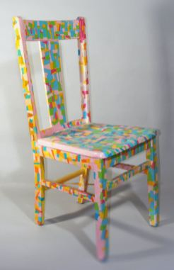 Confetti Chair – 17 x 38 x 20 Wooden chair decoupaged with bits of torn colored paper.