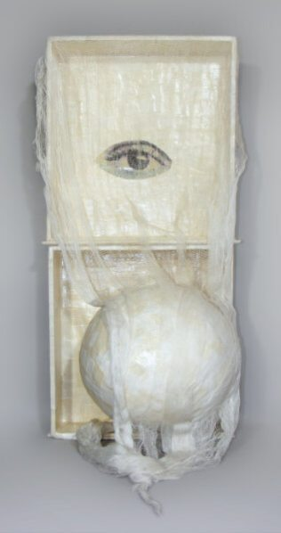 (Eye/Ball unknown title) – 11 x 36 x 9.5 Mixed media. Decoupaged box, ball, cloth.