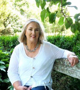 Photo of Leigh DÁnsey in the garden.