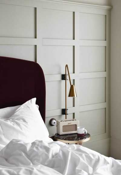 Bedroom with wall panelling