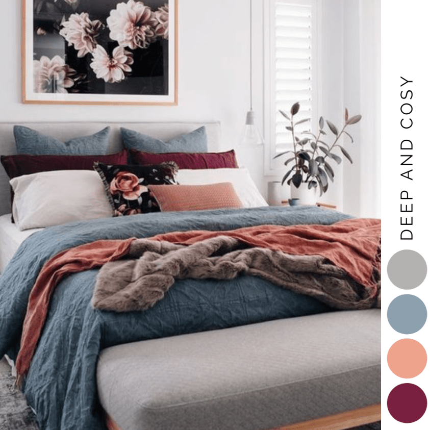 Bedroom with coral pink, burgandy and blue colour scheme bedding