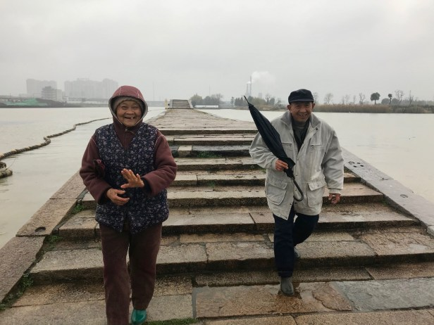 Old couple crossing Precious Belt Bridge Baodai Bridge Suzhou China