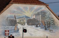 Commemorative mural at the entrance of our village