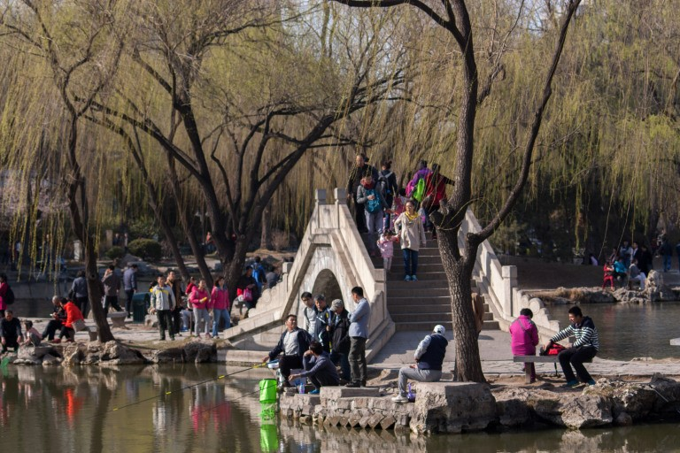 People enjoying a park in the Beijing spring. Photo © Timothy Van Gardingen