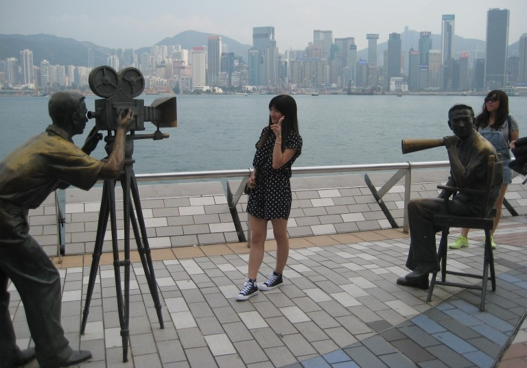 "Tourists getting their 15 seconds of the ""Hong Kong Dream."" (Photo: Ana Ribeiro)"