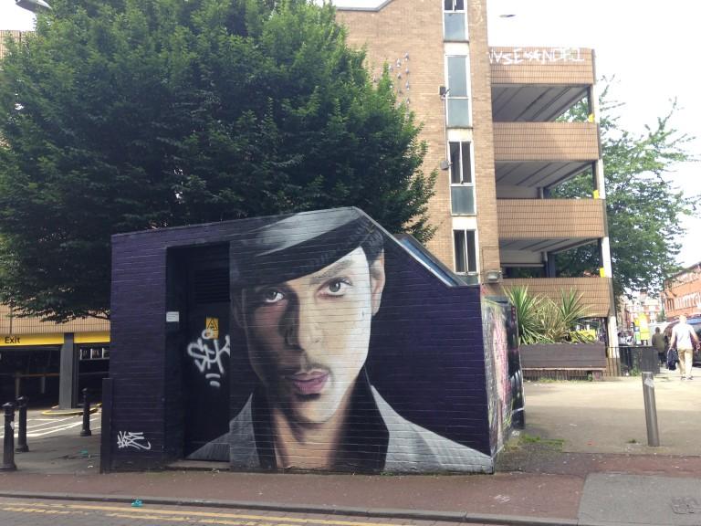 Memorial urban art depicting US pop star Prince on Tib Street, Manchester. Art by Akse. Photo: Ana Ribeiro