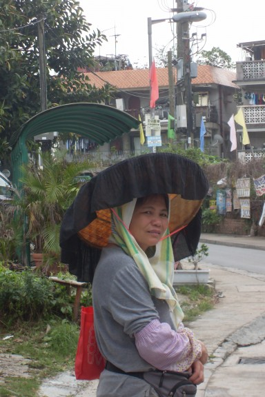 Lady in a Tang hat. (Photo: Helena Flam)