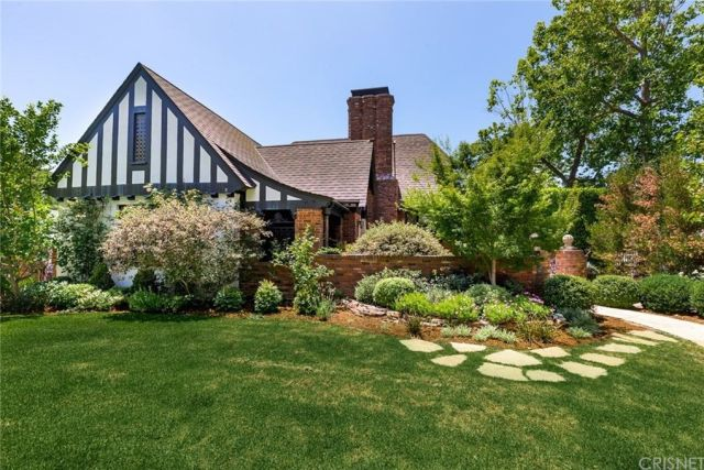 Tudor style home sits amongst its gardens on corner lot in Los Angeles