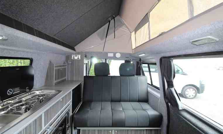 rear seats of Bed unfolded in Kitchen area in Crusader Campervan