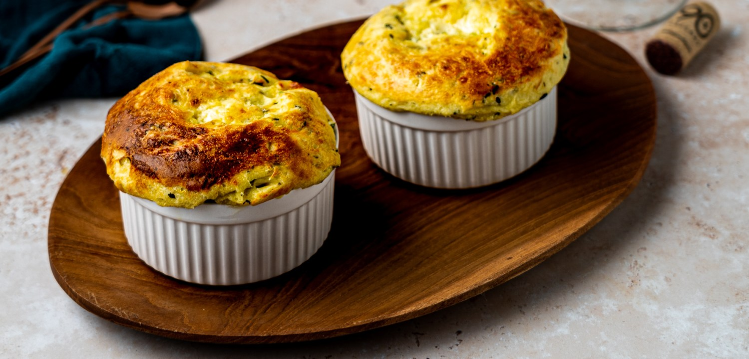 Header shot of two herbed goat cheese soufflés