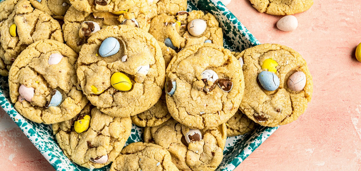 Header photo of a tray of sugar cookies decorated for Easter with Cadbury Mini Eggs