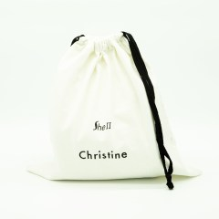 100% natural cotton material with a drawstring closure at the top