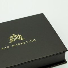 Specialty gift card box with matte lamination, greyboard interior, debossing and gold foil combination and magnetic closure