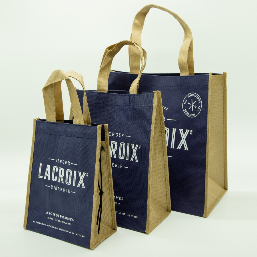 Three reusuable navy and tan reusable bags for La Croix Cidrerie.