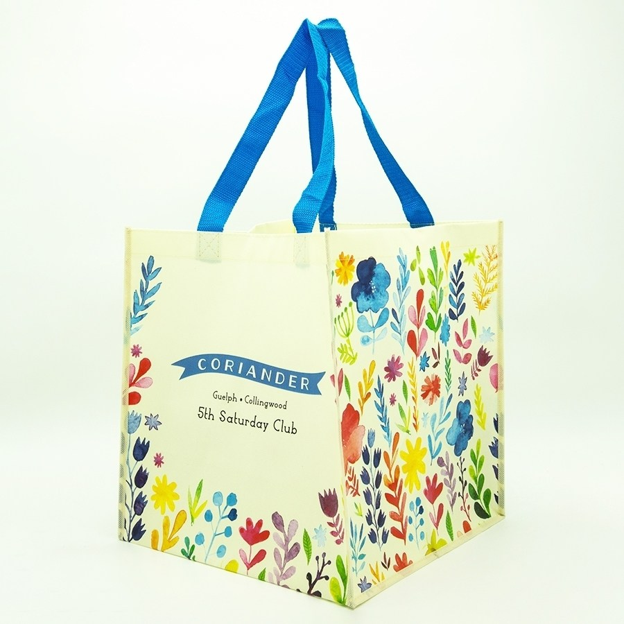 A reusable bag from Coriander, with watercolour-printed floral illustrations.