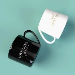 black and white mugs shown with one colour logo prints and a comfortable handle for easy handling