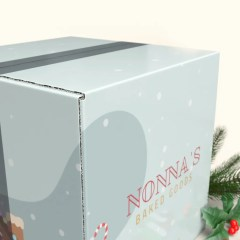 corrugated shipping boxes secured with transparent tape, donning a full colour full coverage print